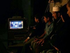 1227818788palestinians_watching_tv.jpg