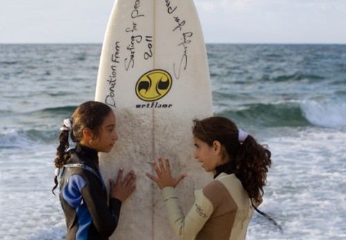 Sisters-Sabah-and-Shrouq-Abu-Gunaim-girls-surfing-in-the-Gaza-Strip.jpg
