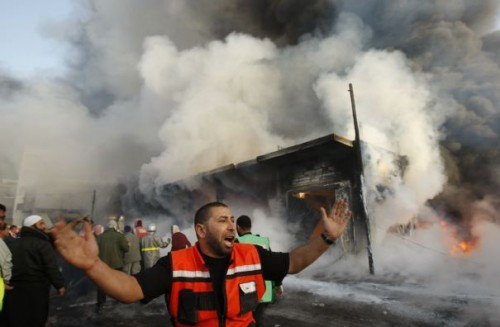 1-a-palestinian-fire-fighter-shouts-in-front-of-a-burning-building-following-an-israel-air-strike-in-gaza-strip_130.jpg