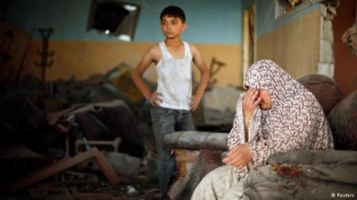 Woman and son in destroyed home Reuters.jpg